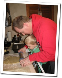 Helping daddy make biscochitos - rolling out the dough