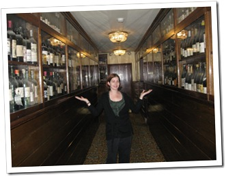 Jen with the liquor collection from Prohibition in the Broadmoor